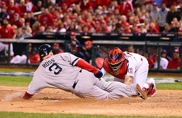 Yadier Molina applies the tag on a throw from center fielder Shane Robinson.