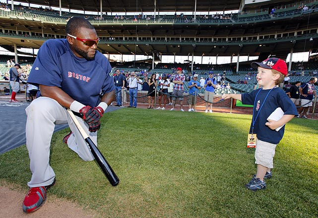 A young fan approaches Ortiz for an autograph before a game between the Red Sox and Cubs at Wrigley Field.
