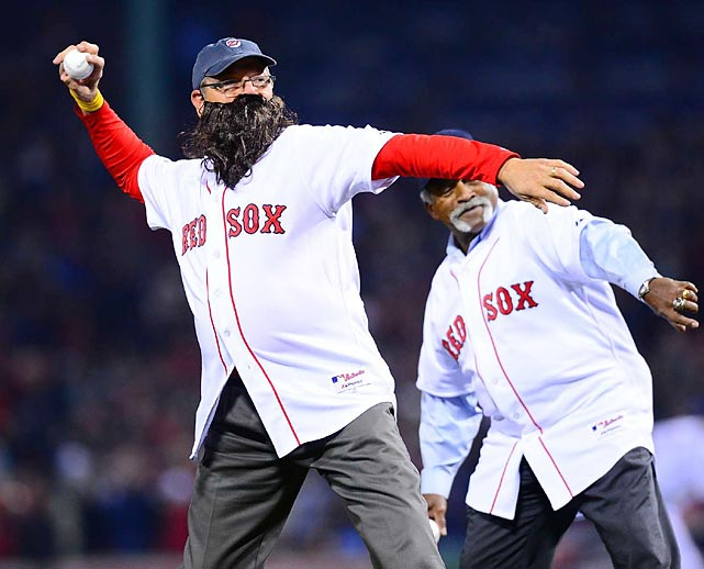 Red Sox legend Carlton Fisk throws out the ceremonial first pitch, complete with a fake beard.