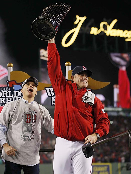 Manager John Farrell hoists Boston's eighth World Series trophy.