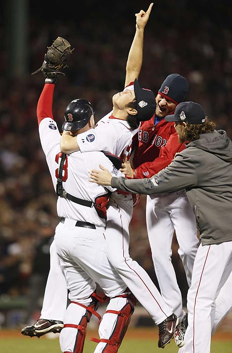 Koji Uehara celebrates after striking out Matt Carpenter for the last out of the World Series.