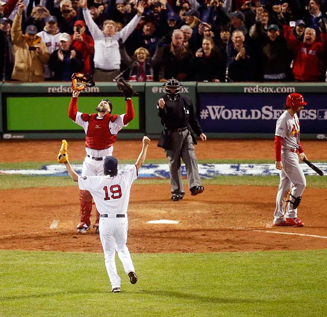 Koji Uehara and David Ross celebrate the final out.