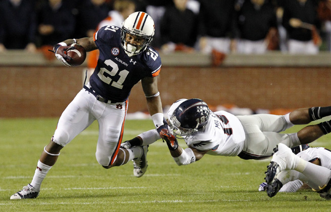 Tre Mason (21) will lead Auburn's fifth-ranked rushing offense against Arkansas' porous run defense.