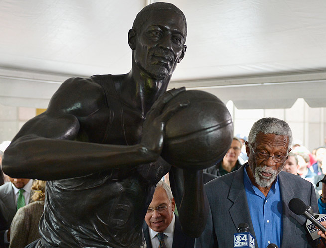 Celtics great Bill Russell speaks with reporters next to a 600-pound bronze statue in his honor.