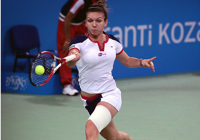 Simona Halep rallied from a set down against Samantha Stosur to win the Tournament of Champions.