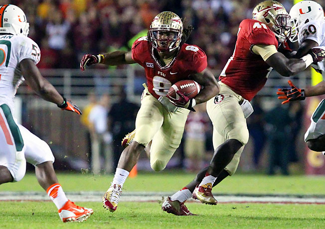 Florida State's Devonta Freeman (8) accounted for 176 total yards and three TDs in a victory over Miami.