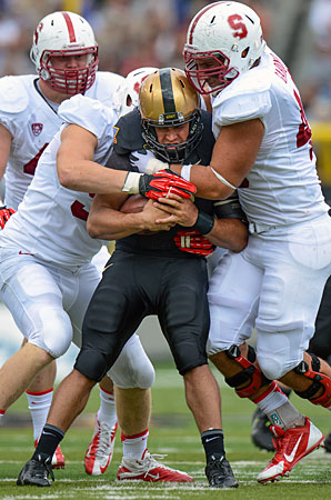Stanford's Trent Murphy (left) and Ben Gardner teamed up to tackle Army quarterback Angel Santiago during the teams' Sept. 14 matchup.