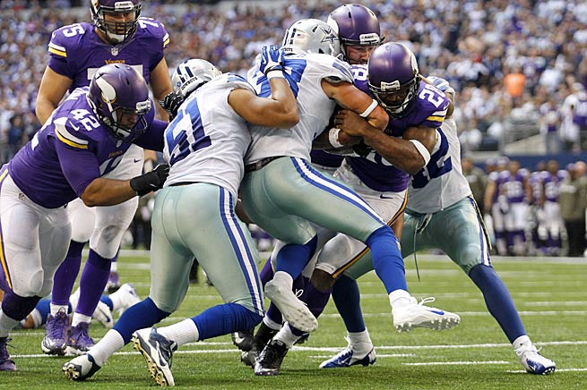 Adrian Peterson got a little help from his friends in powering through the Cowboys for a go-ahead touchdown.