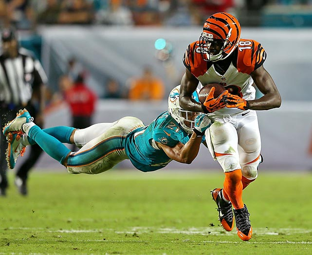 Bengals wide receiver A.J. Green shrugs off a tackle from Dolphins defensive back Brent Grimes. Green was unstoppable most of the night, and finished with 11 catches for 128 yards.