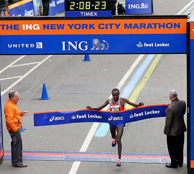 Geoffrey Mutai of Kenya crosses the finish line in Central Park to win the 2013 ING New York City Marathon.