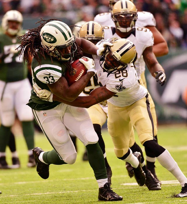 Jets running back Chris Ivory stiff arms Saints cornerback Keenan Lewis.