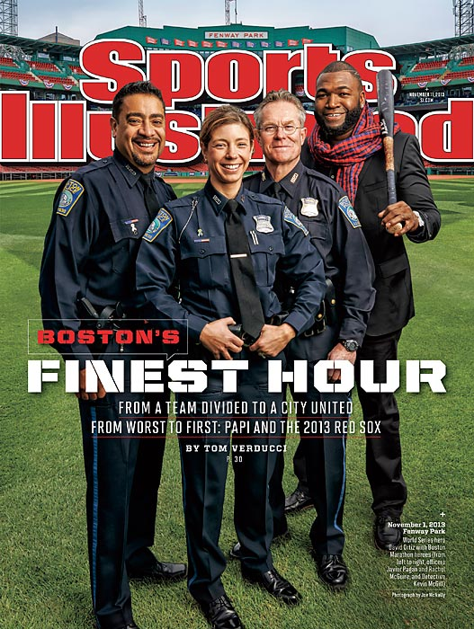 Three members of Boston's Finest are joined on the newest cover of Sports Illustrated by a hero of a different sort, World Series MVP David Ortiz. Big Papi has been a legend in Beantown since helping the Red Sox win their first championship in 86 years back in 2004 but he became even more important to the city this year, as SI senior writer Tom Verducci explains in this week's cover story.