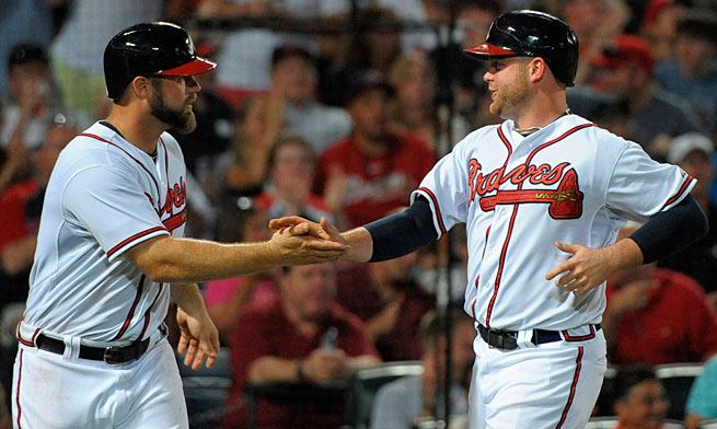 Evan Gattis (left) is just one option to replace seven-time All-Star Brian McCann at catcher in Atlanta.