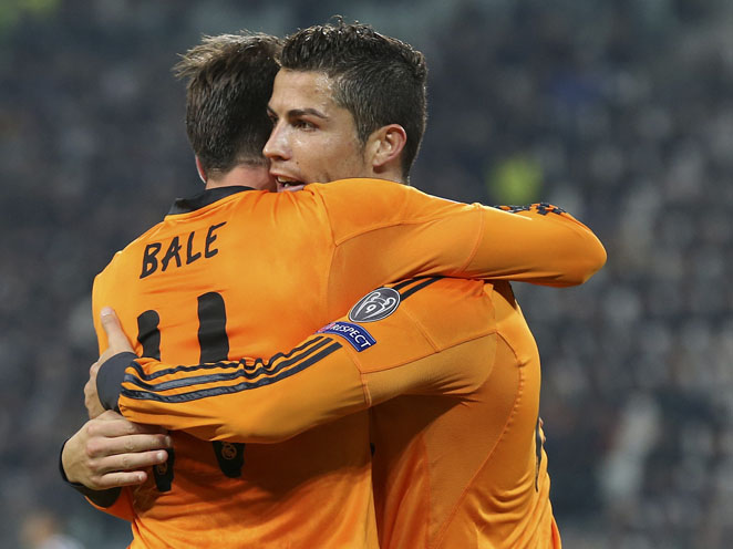 Cristiano Ronaldo and Gareth Bale celebrate after a goal in Real Madrid's 2-2 Champions League draw with Juventus.