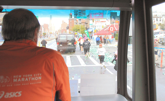 Volunteer Roger Bennorth rides the sweep bus, which picks up runners who can't finish the marathon.