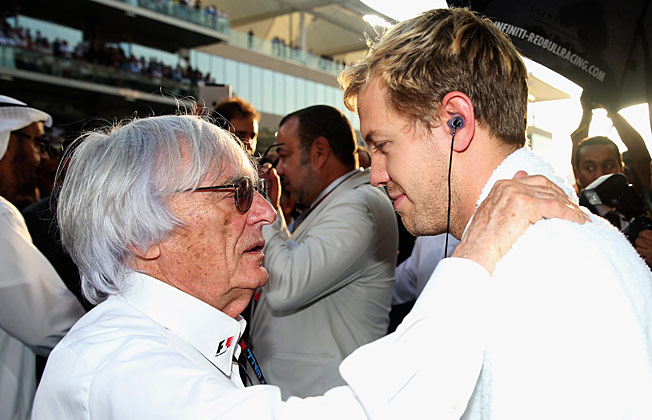 Formula One President Bernie Ecclestone (with Sebastian Vettel) iis accused of making a corrupt deal.