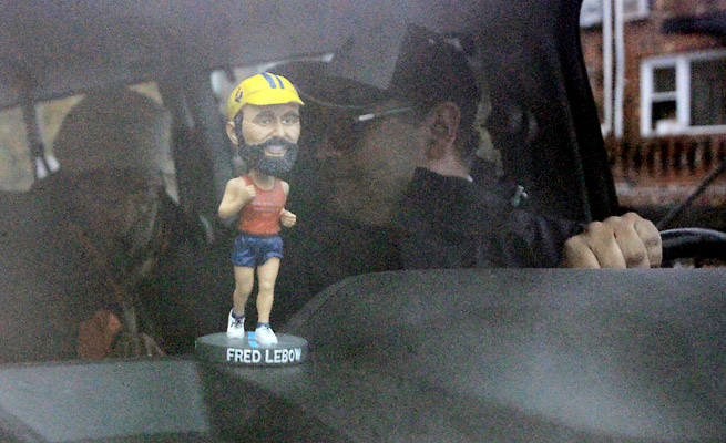 The spirit of Fred Lebow, founder of the New York City Marathon, continues to show in the custom bobblehead that rides in the sweep van and the thick beards many of the male volunteers grow.