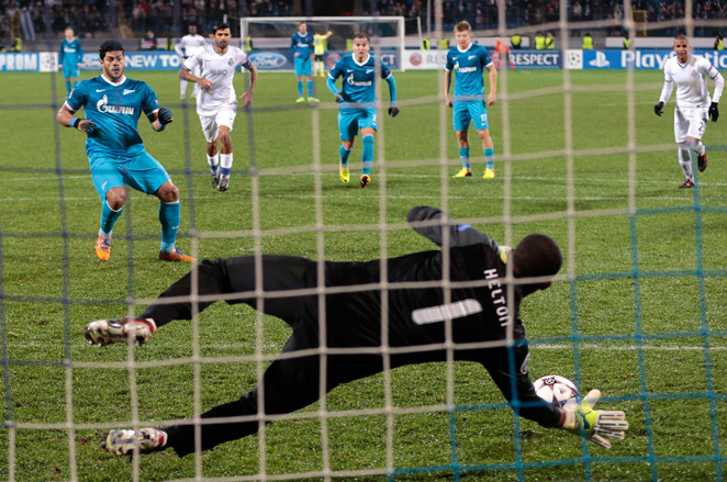 Zenit St. Petersburg forward Hulk has his penalty kick saved by Porto goalkeeper Helton in Wednesday's 1-1 Champions League draw.