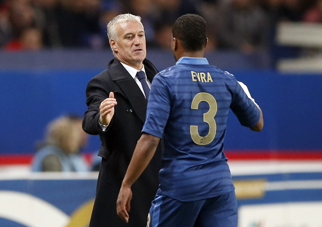 France manager Didier Deschamps (left) is none too pleased with the media questions surrounding his selection of defender Patrice Evra after the player's critical comments of French team analysts.