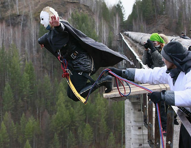 A brave member of the amateur rope-jumping group brings us to the conclusion of this week's thrilling installment by plunging from a 144-foot-high waterpipe bridge in the Siberian Taiga. Fans of rope-jumping, a kind of extreme sport, we guess you could call it, use an advanced leverage system that combines mountaineering and rope safety equipment plus a whole lotta prayer. They marked the end of the group's jumping season, and our gallery, with this event. Thank you.