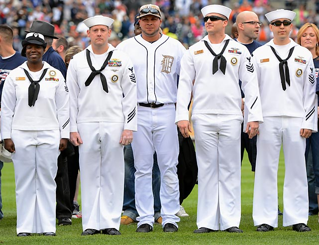 Tigers shortstop Jhonny Peralta stands with military members at a Memorial Day ceremony before Detroit's game against the Pirates in 2013.