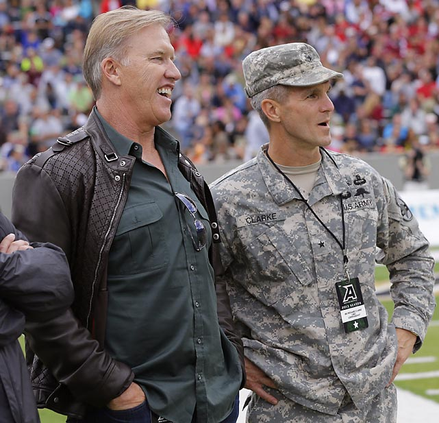 Hall of Fame quarterback John Elway chats with Brigadier Gen. Richard Clarke during Elway's alma mater Stanford's win over Army in September.