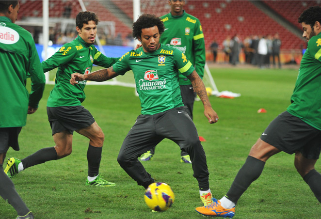 Brazil and Real Madrid defender Marcelo (center) is out of the Selecao's squad for a pair of upcoming friendlies after suffering a knee injury.