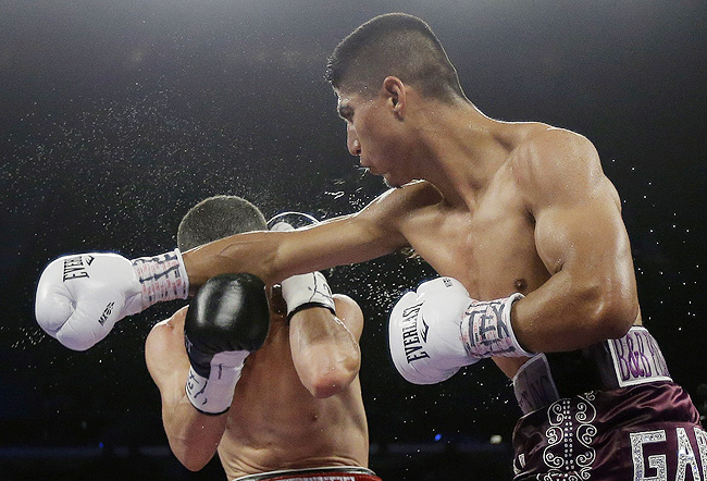 Garcia (right) improved to 33-0 with his 28th knockout in the 8th, while Martinez dropped to 27-2-2.