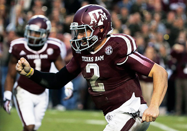 Johnny Manziel passed for 446 yards with five TDs in Texas A&M's 51-41 victory over Mississippi State.