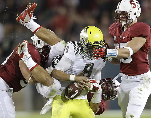 Stanford linebacker A.J. Tarpley forces Oregon quarterback Marcus Mariota to fumble. Stanford handed Oregon its first loss of the season, 26-20.