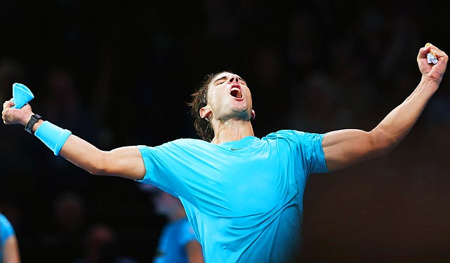 Rafael Nadal celebrates winning his singles match against Stanislas Wawrinka of Switzerland during day three of the Barclays ATP World Tour Finals.