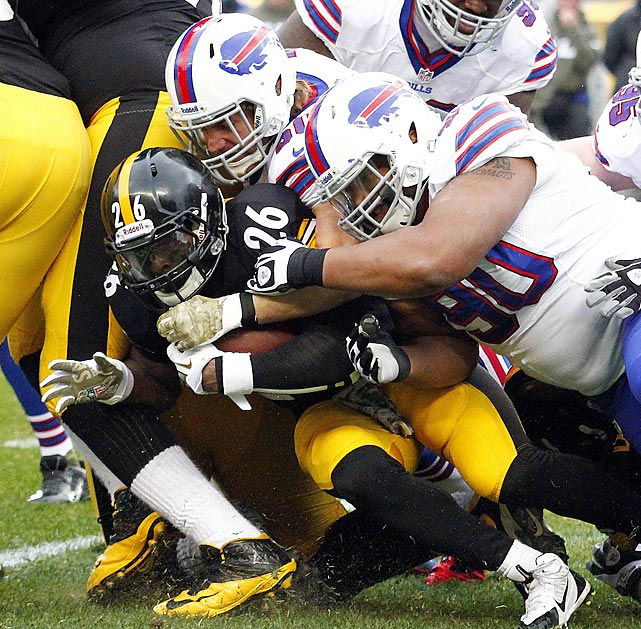 Steelers running back Le'Veon Bell is tackled by Bills defensive tackle Alan Branch. Pittsburgh topped Buffalo 23-10 in E.J. Manuel's first game back from injury.