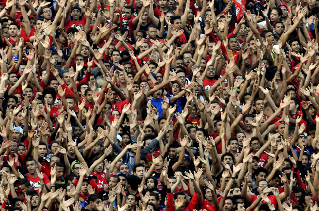 Al Ahly fans cheer during the second leg of the African Champions League final.