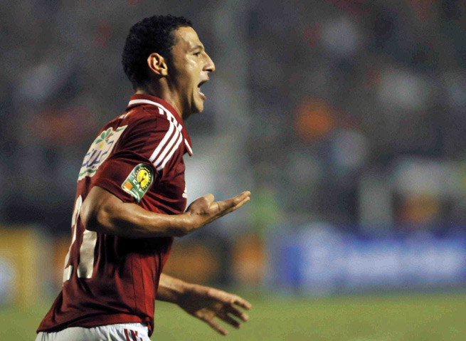 Al Ahly's Ahmed Abdul Zaher gives a four-fingered salute after scoring in the African Champions League final last Sunday. His club will sell him as a result of the gesture, which has political ties.