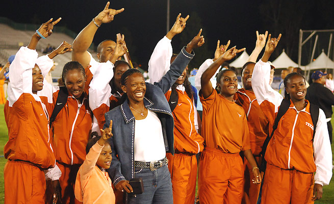 Bev Kearney (front, in jeans) became the first black head coach hired at Texas in 1993.
