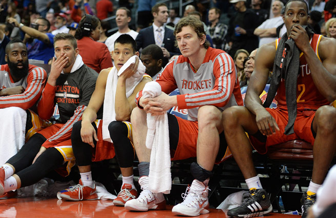 Unhappy with his role, Omer Asik (center) has reportedly requested a trade from the Rockets.