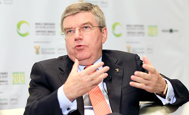 "IOC President Thomas Bach praised the tougher penalty but said the ban alone was ""not enough."""