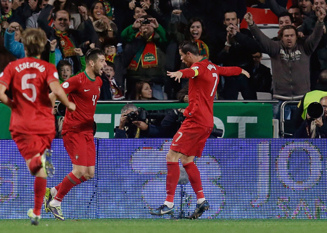 Portugal's Cristiano Ronaldo (7) celebrates his game-winning goal that gives his side the 1-0 edge over Sweden heading into the second leg of their World Cup qualifying playoff.