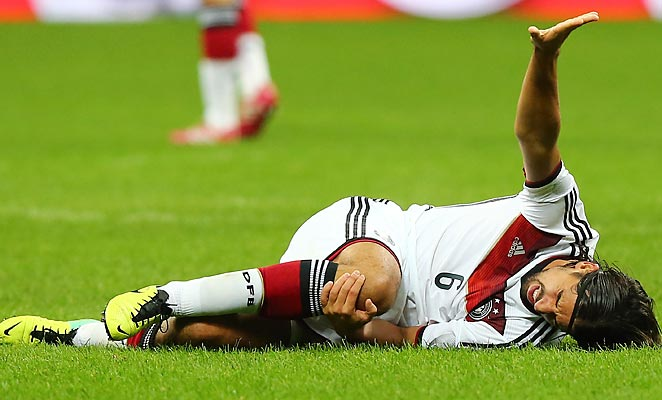 Sami Khedira went down after a tackle by Andrea Pirlo in the second half.