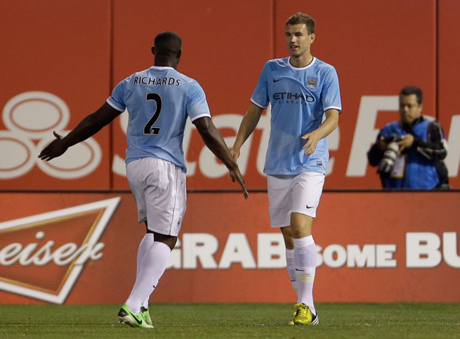 Manchester City striker Edin Dzeko, right, shown celebrating a goal against Chelsea at Busch Stadium in St. Louis in May, will be one of the main attractions in his return to the venue when Bosnia-Herzegovina plays in front of the city's bountiful Bosnian demographic Tuesday.