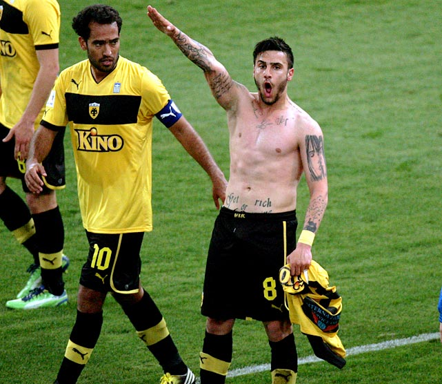 The 20-year-old AEK Athens midfielder celebrated a game-winning goal in March with a Nazi salute. Following the game, the Greek soccer federation EPO banned him for life from participating on any national teams. For his part, Katidis claimed to have never heard of Adolf Hitler and not to know what the gesture meant. AEK Athens eventually suspended him for the rest of the year; Katidis is now trying to salvage a career with Italian Serie B club Novara.