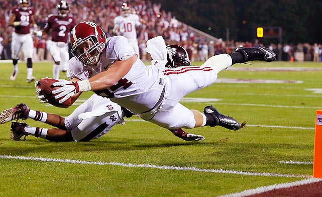 Alabama tight end Brian Vogler extends for a touchdown against Mississippi State. Alabama won 20-7 to remain unbeaten.