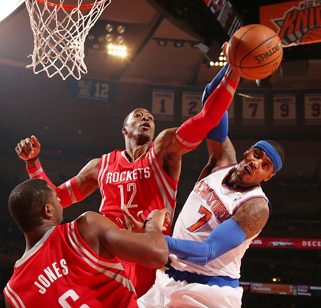 Rockets center Dwight Howard blocks a Carmelo Anthony layup attempt. Howard is averaging 17.8 points and 14.2 rebounds per game with his new team.