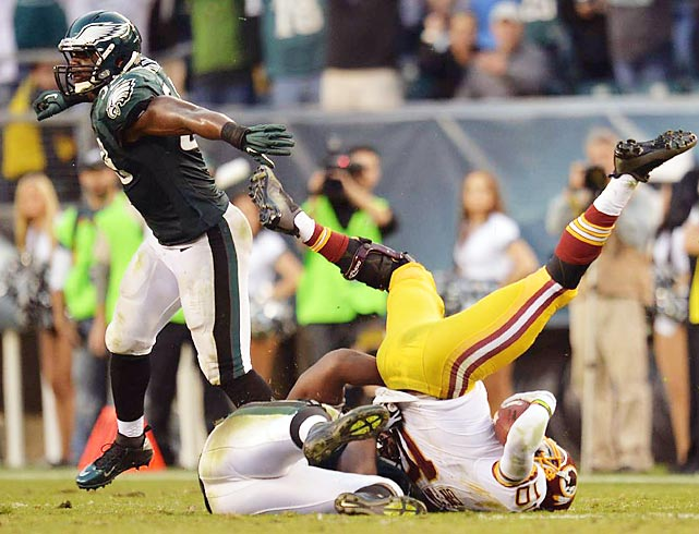 Eagles defenders take down Redskins quarterback Robert Griffin III. Philadelphia moved into first place in the NFC East with its 24-16 win.