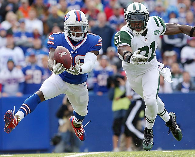 Buffalo wide receiver Marquise Goodwin can't quite haul in a pass with Jets corner Antonio Cromartie in coverage.