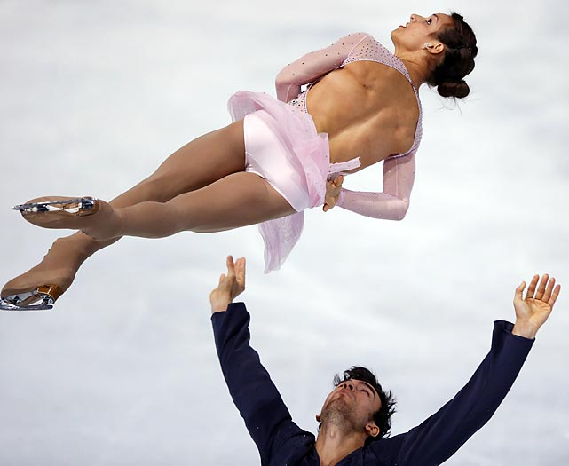 Meagan Duhamel and Eric Radford of Canada perform their Pairs Short Program during the ISU Figure Skating Eric Bompard Trophy in Paris.