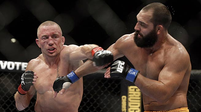 Georges St-Pierre (left) took as much of a beating as he gave in his win over Johny Hendricks at UFC 167.