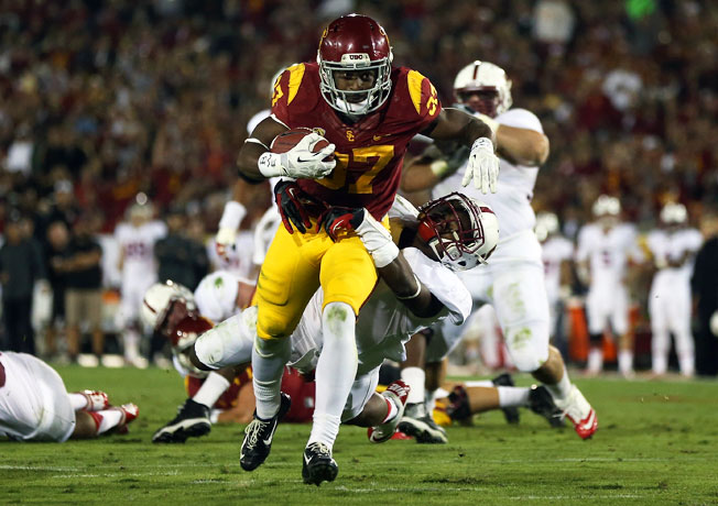 Javorius Allen (37) and USC shook up the bowl projections with their upset of Stanford on Saturday.