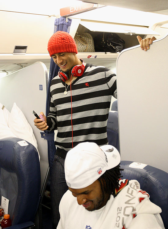 Colin Kaepernick is all smiles as the 49ers return home from Atlanta following their NFC Championship win over the Falcons.