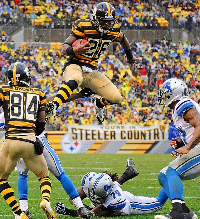 Le'Veon Bell (26) of the Steelers, who were attired in their throwback penitentiary garb, tried to make a break for it against the Lions at Pittsburgh's Heinz Field. He met with an unfortunate end. Here's his story.